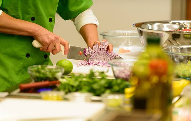 Cutting red onion at Lee Health Teaching Kitchen